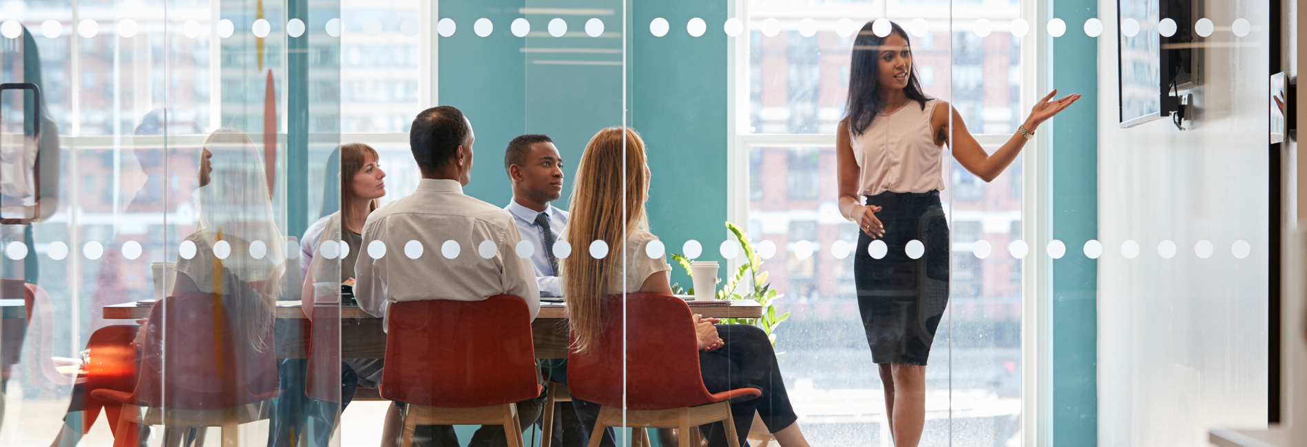 Young woman presenting in a boardroom